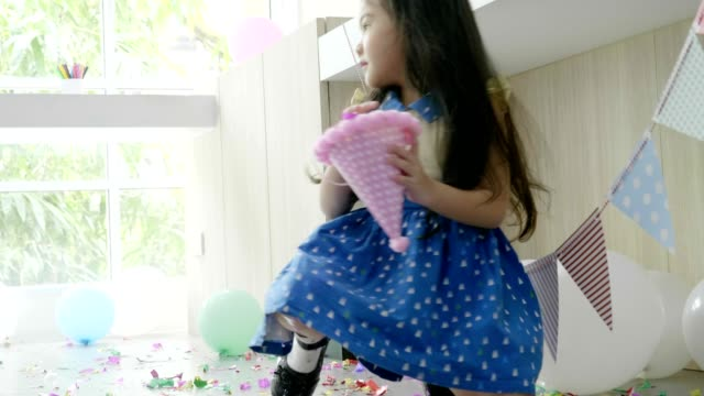 cute girl keeping confetti in messy floor - sunday stock videos & royalty-free footage
