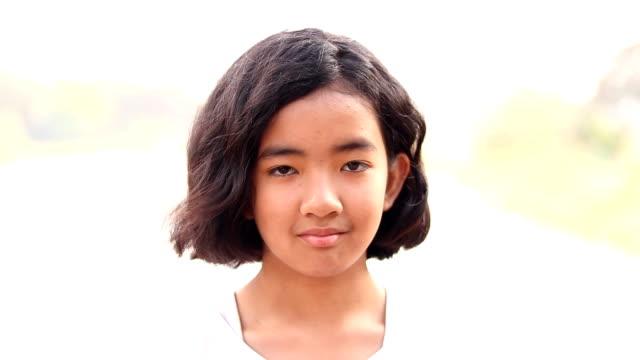 cute girl make eyes. eyebrow - winking stock videos & royalty-free footage
