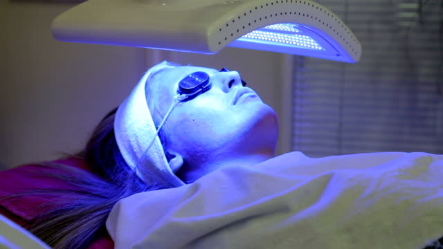 cute girl on led light therapy - alternative therapy stock videos & royalty-free footage