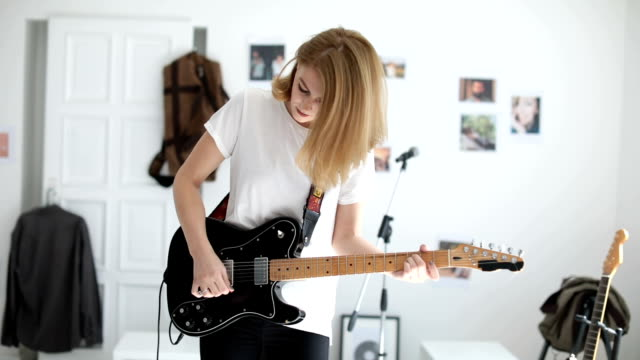 cute girl playing guitar - performance group stock videos & royalty-free footage