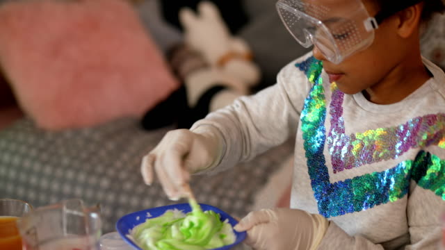 cute girl playing with slime - childhood stock videos & royalty-free footage