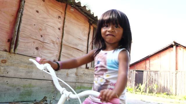 cute girl portrait riding a bicycle in the rural place - south america stock videos and b-roll footage