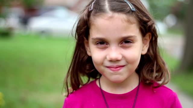 cute girl smiles - sideways glance stock videos & royalty-free footage