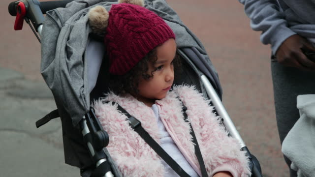 cute girl smiling in her stroller - woolly hat stock videos & royalty-free footage