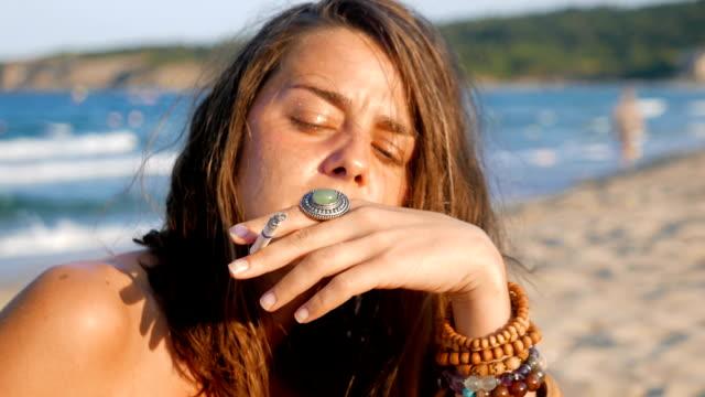 cute girl smoking cigarette on the beach - little girl smoking cigarette stock videos and b-roll footage
