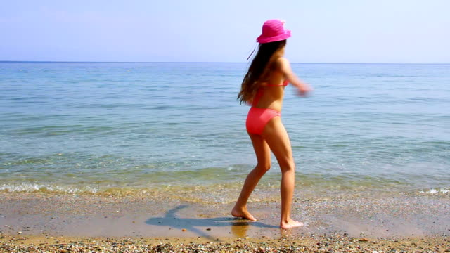 cute girl spinning. - swimwear stock videos & royalty-free footage