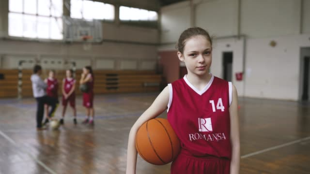 cute girl standing in front of coach and teammates on practice - teenage girls stock videos & royalty-free footage