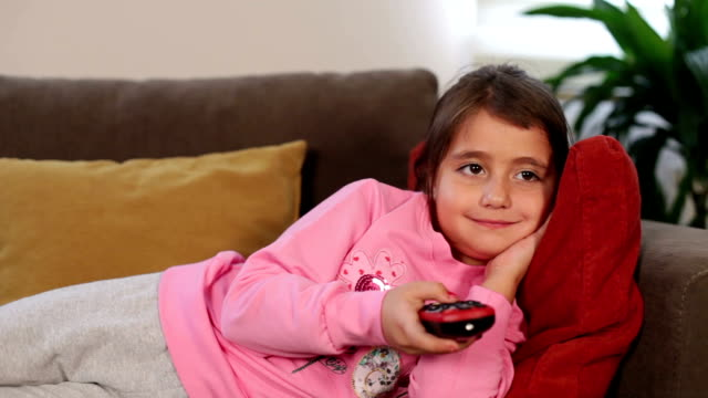cute girl watching television - cartoon p stock videos & royalty-free footage