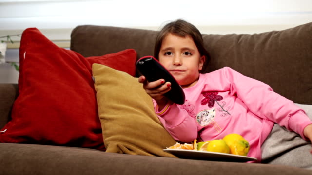 cute girl watching television - changing channels stock videos & royalty-free footage