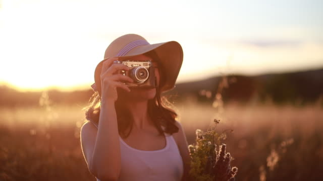 cute girl with a camera photographing nature - analog stock videos and b-roll footage