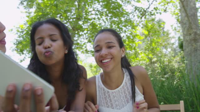 cute girlfriends taking selfies at a caf_ - durevolezza video stock e b–roll