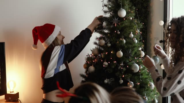cute girls decorating christmas tree - slumber party stock videos and b-roll footage