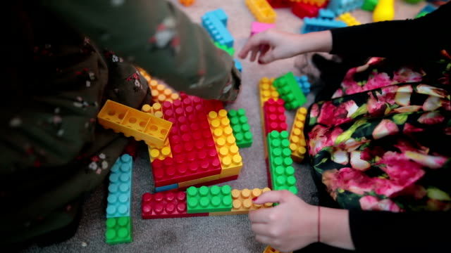 cute girls in kindergarten playing with toy blocks - preschool stock videos & royalty-free footage