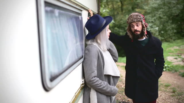 cute hipster couple in front of a vintage camper trailer - vintage car stock videos and b-roll footage