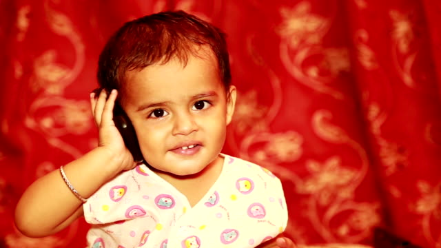 cute infant talking on mobile phone - one baby boy only stock videos & royalty-free footage