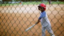 Cute kid batting during baseball practice