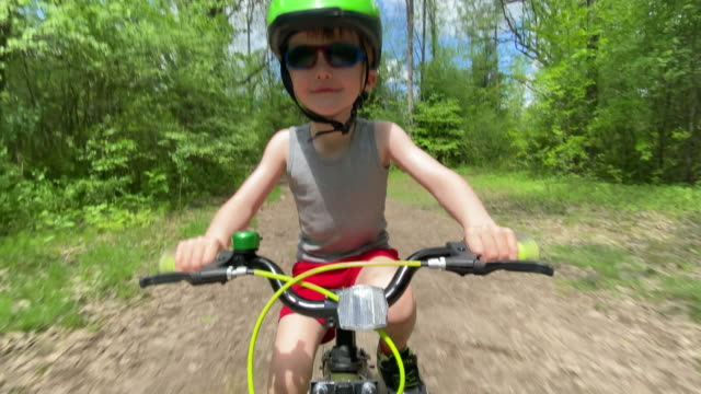 cute kid cycling in the forest - footpath stock videos & royalty-free footage
