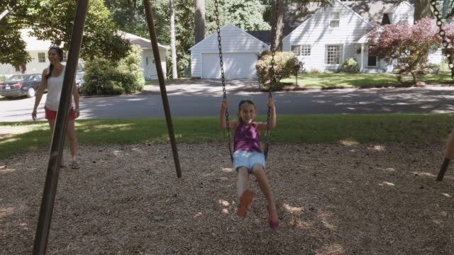 cute kids on a swing set - swinging stock videos & royalty-free footage