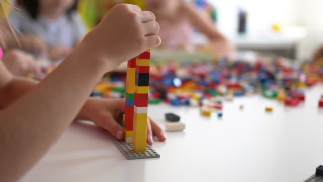 cute kids playing with toy blocks in school - preschool building stock videos & royalty-free footage