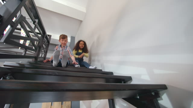 cute kids sliding down stairs - sliding stock videos and b-roll footage