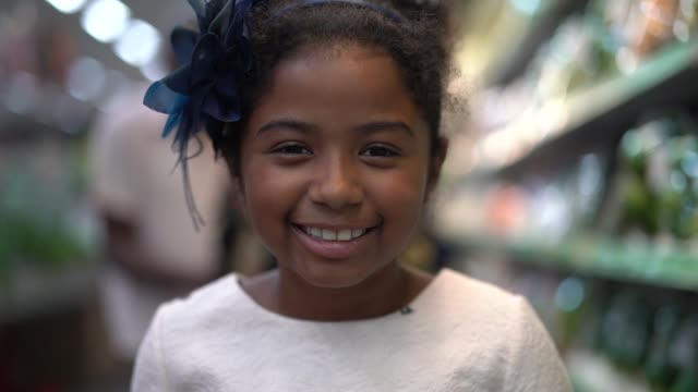 cute little afro latina girl at supermarket - front view stock videos & royalty-free footage