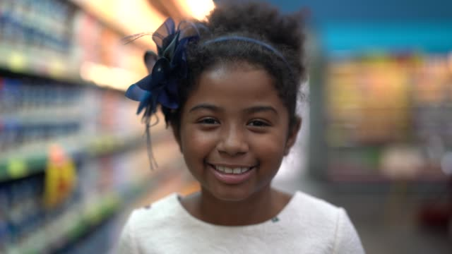 cute little afro latina girl at supermarket - pardo brazilian stock videos & royalty-free footage