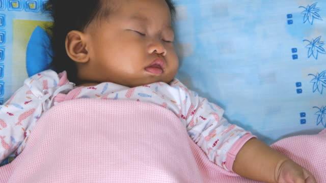 cute little baby daughter is sleeping - hugging self stock videos & royalty-free footage