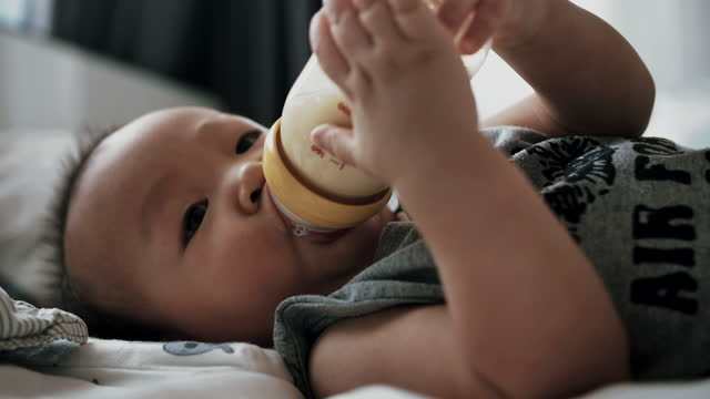 cu : cute little baby eating milk from a bottle - 0 11 months stock videos & royalty-free footage