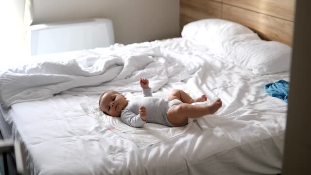 cute little baby laying on the bed - modern manhood stock videos & royalty-free footage
