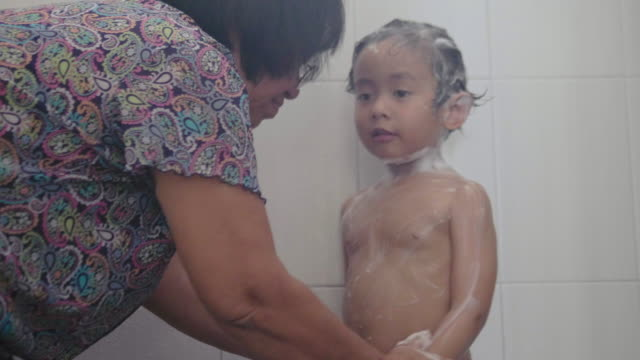 cute little baby taking a shower with grandmother - armpit stock videos and b-roll footage