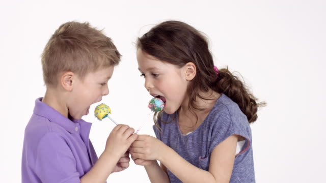 cute little boy (five-years-old) and his sister eating cake pops - lollipop stock videos and b-roll footage