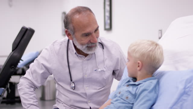 cute little boy in medical appointment with doctor - paediatrician stock videos & royalty-free footage