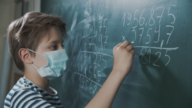cute little boy on math lesson during covid-19 pandemic - school building stock videos & royalty-free footage