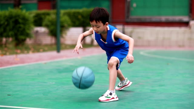 cute little boy playing basketball - basketball sport stock videos & royalty-free footage