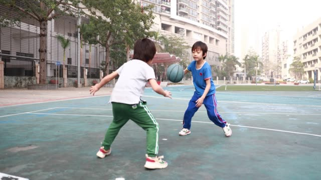 cute little boy playing basketball - brother stock videos & royalty-free footage