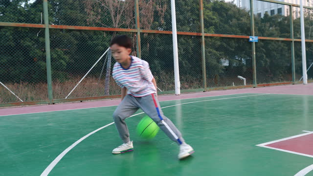 cute little boy playing basketball - childhood stock videos & royalty-free footage