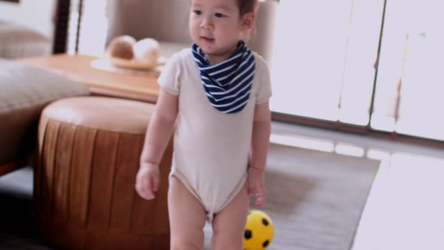 cute little boy playing with soccer ball at home - kicking stock videos & royalty-free footage