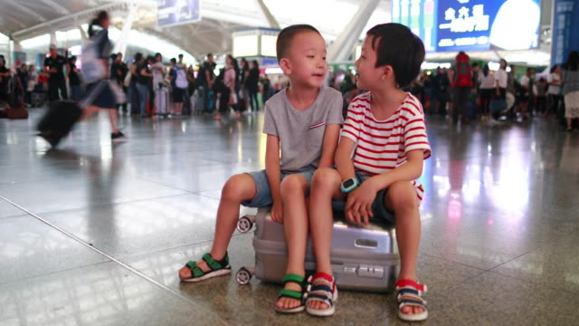 cute little boy waiting in the railway station, child travel - luggage stock videos & royalty-free footage