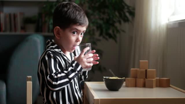 cute little boy water drink - drinking glass stock videos & royalty-free footage