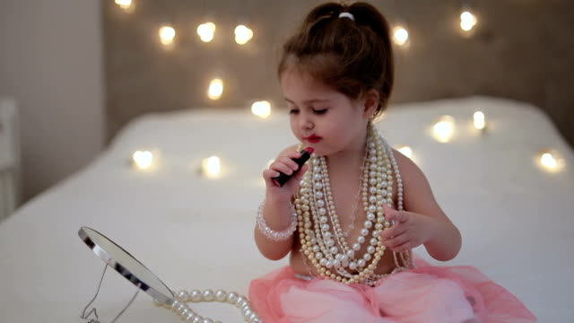 cute little child putting on lipstick - toddler stock videos & royalty-free footage
