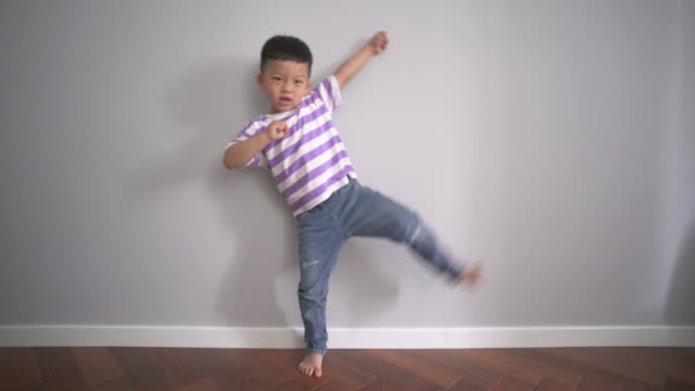 cute little chinese boy in t-shirt and jeans - barefoot stock videos & royalty-free footage