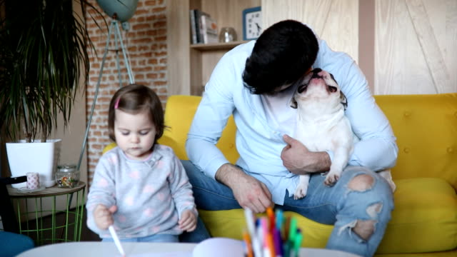 cute little family having fun - panting stock videos & royalty-free footage