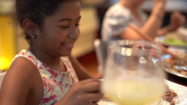 cute little girl at family dinner - social gathering stock videos & royalty-free footage