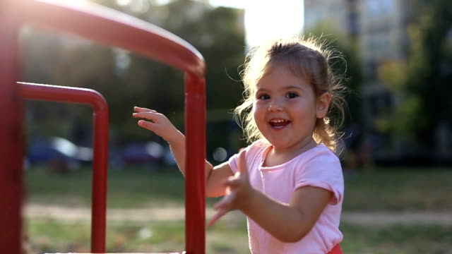cute little girl autumn play - playground stock videos & royalty-free footage