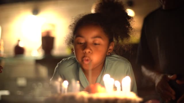 cute little girl celebrating birthday party with her family - anniversary stock videos & royalty-free footage