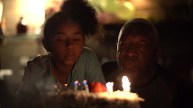 cute little girl celebrating birthday party with her family - candeline di compleanno video stock e b–roll