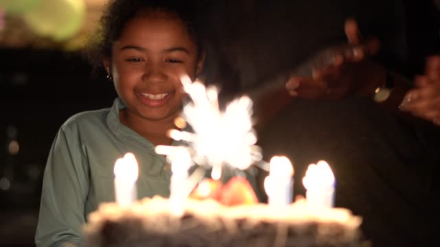 cute little girl celebrating birthday party with her family - birthday cake stock videos & royalty-free footage