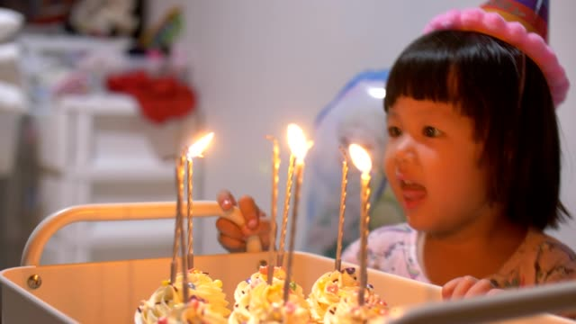 cute little girl celebrating her birthday party at home - 2 3 years stock videos & royalty-free footage