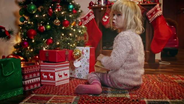 cute little girl decorating christmas tree - stockings stock videos & royalty-free footage