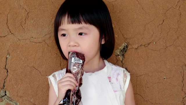 cute little girl(4-5 years) eating chocolate ice cream - 4 5 years stock videos & royalty-free footage
